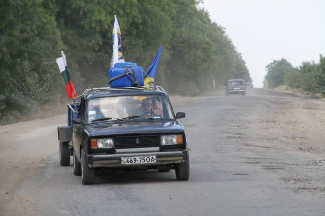 Петр Зотович на автомобиле сопровождения фото С.Матушкина